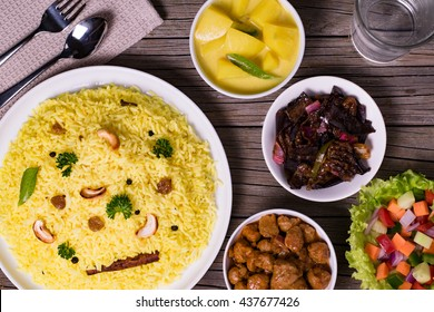 Yellow rice and curry or kaha bath in wooden background Sri Lankan food