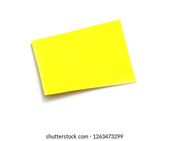 yellow ripped paper on white background