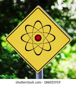 Yellow road sign outdoor with nuclear pictogram
