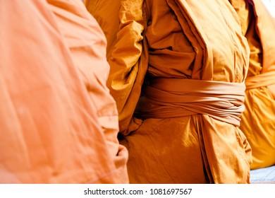 Yellow robe of Buddhist monks, Closeup on buddhist monk
