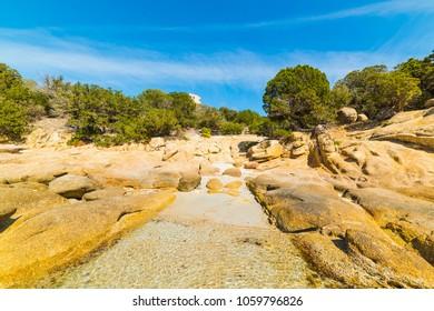 Yellow rocks in Cala Pira shoreline, Villasimius. Sardinia, Italy