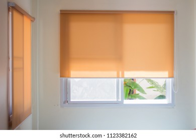 yellow roll blinds,shutter to protect sunlight.