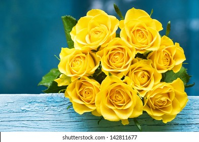 Yellow Roses Bouquet on the blue wood