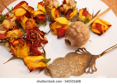 yellow roses, poppy seeds and a shovel for a cake on a white background