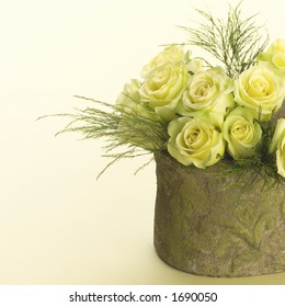 Yellow roses in a pot.