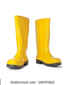 Yellow rubber boots isolated on white
