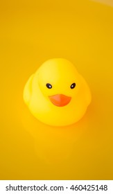 Yellow rubber duck - bath toys on a yellow background