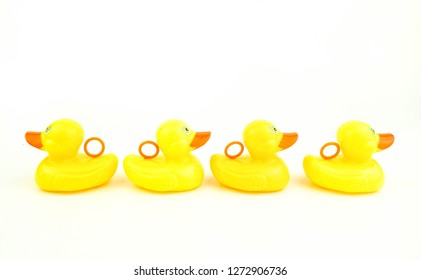 A yellow rubber duck left the duck group. Dare to be different concept or not follow the rule concept.
