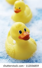 Yellow rubber ducks in bubble bath