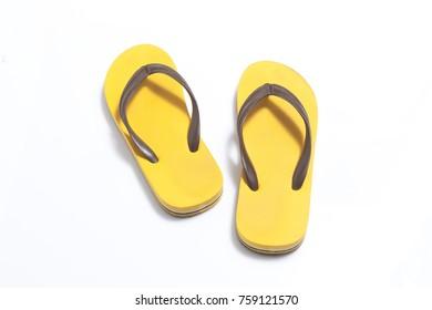 yellow rubber sandal flip flops on white background