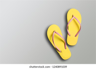 bc904a0cd17 Yellow rubber sandals flip flops on wooden background