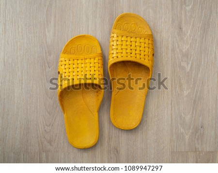 1e73297b1 Yellow Rubber Sandals Flip Flops on Bright Wooden Background Top View