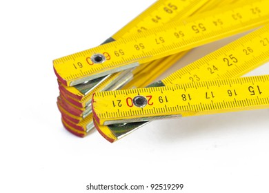 A yellow ruler on a white background