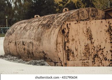 yellow rusty abandoned tank lying on the beach