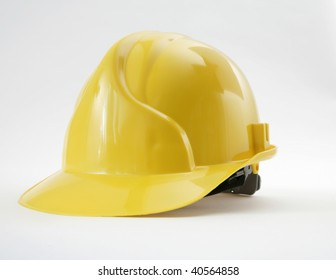 yellow safety headgear on white background