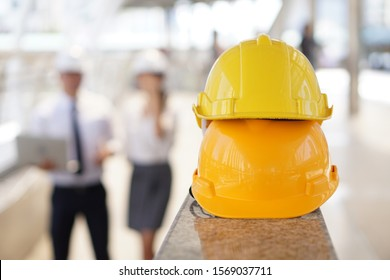 yellow safety helmet hat for safety project of workman on construction site building
