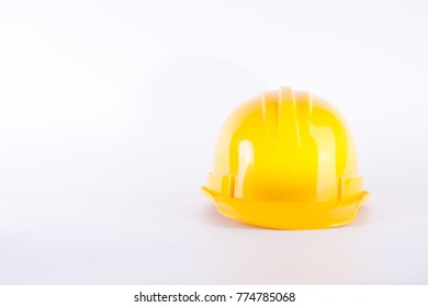 Yellow safety helmet on white background. Hard hat isolated on white. Safety equipment concept. Worker and Industrial theme.