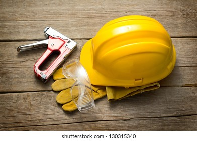 Yellow safety helmet and working tools