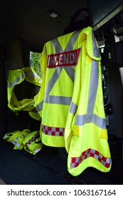 A yellow safety vest with the word incendies