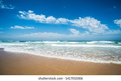 Yellow sand beach, sea and deep blue sky.
