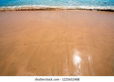 yellow sand beach with waves blue,background nature ocean
