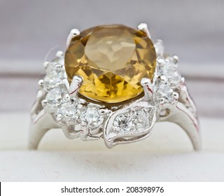 Yellow sapphire ring on white