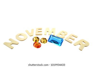 Yellow sapphire,citrine and topaz gemstone birthstone november,isolated on white background