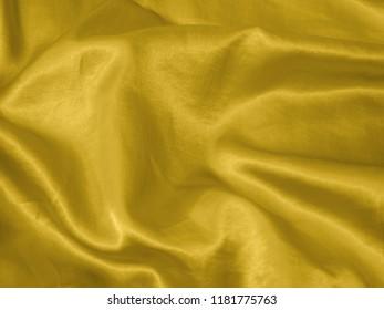 Yellow satin silk texture.