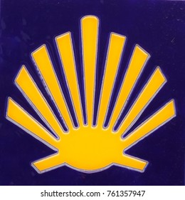 the yellow scallop shell, the symbol of the christian pilgrimage route of camino de santiago in spain