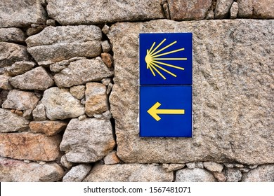 Yellow scallop shell, touristic symbol of the Camino de Santiago showing direction on Camino Norte in Spain. Signing the way to Santiago De Compostela on the St James pilgrimage route.