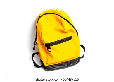 Yellow school backpack isolated on white background.