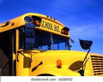 Yellow school bus against blue sky