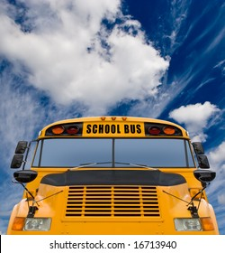 Yellow school bus against deep blue sky with clouds