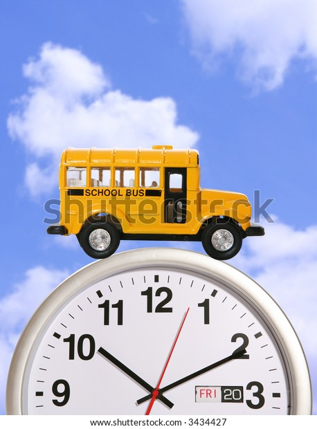 A yellow school bus driving on a clock