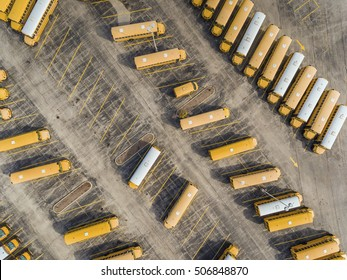 Yellow School Bus on the large parking lot. Aerial top view