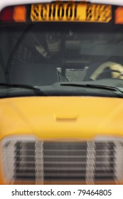 Yellow school bus seen in the motion