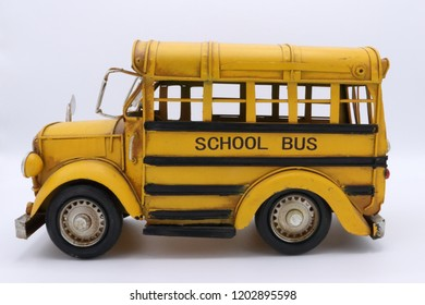 Yellow school bus side view in white background
