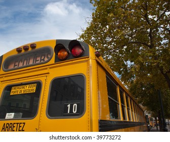 Yellow school bus with signage in French and English