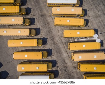 Yellow School Busses aerial top view.