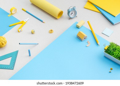 Yellow school supplies, creative flat lay desk.