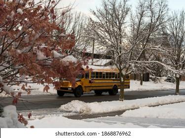 Yellow schoolbus on a snowy street