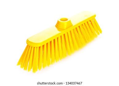 Yellow scrubbing broom on white background