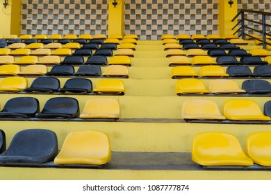 Yellow seats on the grandstand of the football stadium, Outdoors empty grandstands temporary builded for country town parade