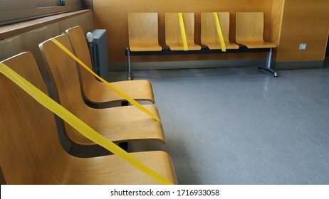 Coruña-Spain. Yellow security tape in waiting room to maintain the security distance during the state of alarm in Spain on April 28, 2020
