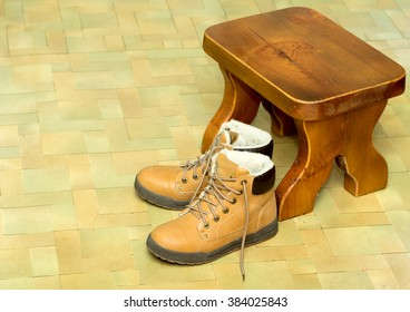 yellow shoes on the floor with a stool