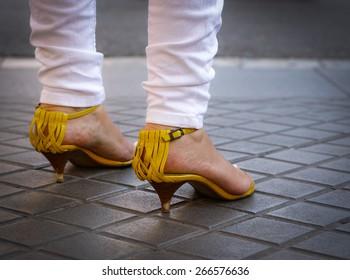 Yellow shoes, white pants