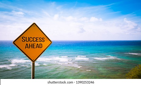 A yellow sign with the background of the clear sky and the sea. Image for business concept toward success