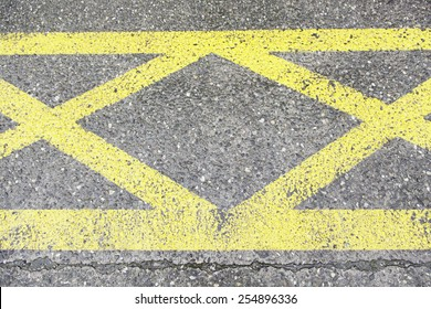 Yellow sign on asphalt, detail of an information signal, traffic
