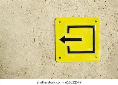Yellow sign symbol evacuation pointer exit left