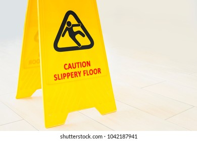 Yellow sign that alerts for wet floor in office building